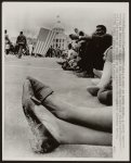 A pair of muddy shoes underscore the weariness following the 1965 march from Selma to Montgomery, Alabama; state capitol in background