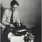 Alan Lomax at typewriter, ca. 1940s.